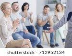 man standing in front of... | Shutterstock . vector #712952134