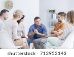 focused man talking to people... | Shutterstock . vector #712952143