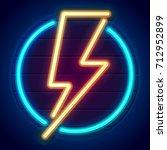 neon lightning bolt on a wooden ... | Shutterstock .eps vector #712952899
