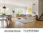 beige sofa with pillows in...   Shutterstock . vector #712955584