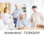 reunion of happy senior people... | Shutterstock . vector #712962619
