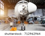 aircraft in the hangar on the c ... | Shutterstock . vector #712962964