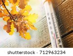 thermometer on the old wooden... | Shutterstock . vector #712963234