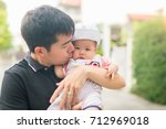 father is carrying the baby... | Shutterstock . vector #712969018