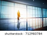 businessman standing alone in... | Shutterstock . vector #712983784