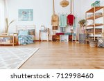 blue painting above king size... | Shutterstock . vector #712998460