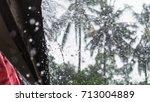 heavy raindrop swash the rooftop | Shutterstock . vector #713004889