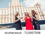 beautiful women near a... | Shutterstock . vector #713007508