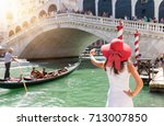 female tourist with a red hat... | Shutterstock . vector #713007850
