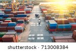 Small photo of Container ship in export and import business and logistics. Shipping cargo to harbor by crane. Water transport International. Aerial view