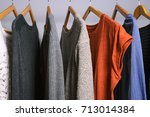 clothing hanging on a clothing... | Shutterstock . vector #713014384