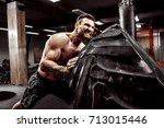 shirtless man flipping heavy... | Shutterstock . vector #713015446