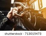 shirtless man flipping heavy... | Shutterstock . vector #713015473