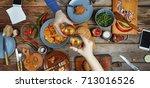 meeting friends at the dinner...   Shutterstock . vector #713016526
