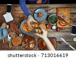 meeting friends at the dinner... | Shutterstock . vector #713016619