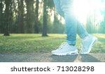 person walking in nice gray... | Shutterstock . vector #713028298