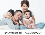 young happy asian family with... | Shutterstock . vector #713030920