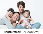 young happy asian family with... | Shutterstock . vector #713031094