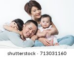 young happy asian family with... | Shutterstock . vector #713031160