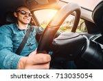 man drives a car   inside wide... | Shutterstock . vector #713035054