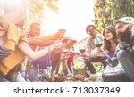 happy friends cheering with... | Shutterstock . vector #713037349