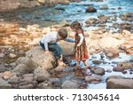 brother and sister barefoot on  ... | Shutterstock . vector #713045614