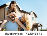 mother and father having fun... | Shutterstock . vector #713049676