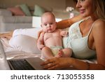mother and her little baby at... | Shutterstock . vector #713055358