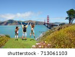 people with hands up jumping ... | Shutterstock . vector #713061103