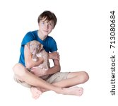 Small photo of A teenager with a puppy of the American pit bull terrier on his hands. Isolated on white background