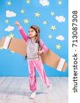 little child girl in an... | Shutterstock . vector #713087308