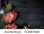 fresh raw beef with basil and a ... | Shutterstock . vector #713087680