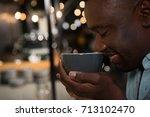 happy man smelling espresso in... | Shutterstock . vector #713102470