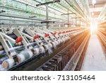 rolls of industrial cotton... | Shutterstock . vector #713105464