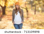 young pregnant woman in casual...   Shutterstock . vector #713109898