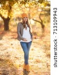 young pregnant woman in casual... | Shutterstock . vector #713109943
