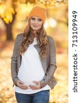 young pregnant woman in casual... | Shutterstock . vector #713109949