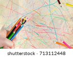 a designer's hand with pencils. ... | Shutterstock . vector #713112448