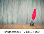 vintage old red quill pen with... | Shutterstock . vector #713137150