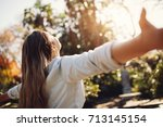 young woman spreading hands... | Shutterstock . vector #713145154