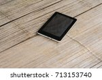 black tablet on the bamboo... | Shutterstock . vector #713153740