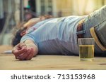 Small photo of Drunken men sleep on the floor until sunrise.