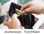 cash money in your wallet in... | Shutterstock . vector #713154664