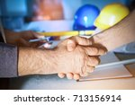 engineers handshake at the... | Shutterstock . vector #713156914