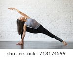 young woman practicing yoga ... | Shutterstock . vector #713174599