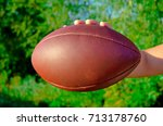 a man holds the ball for... | Shutterstock . vector #713178760