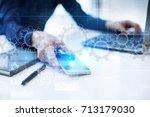 gears on virtual screen.... | Shutterstock . vector #713179030