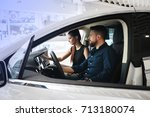 couple chooses the new car in... | Shutterstock . vector #713180074