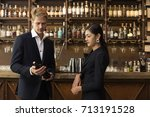 man and woman looking to bottle ... | Shutterstock . vector #713191528