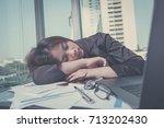 businesswoman sleeping on... | Shutterstock . vector #713202430